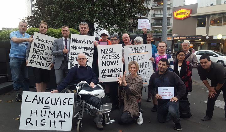 Protesters outside TVNZ's Auckland office.