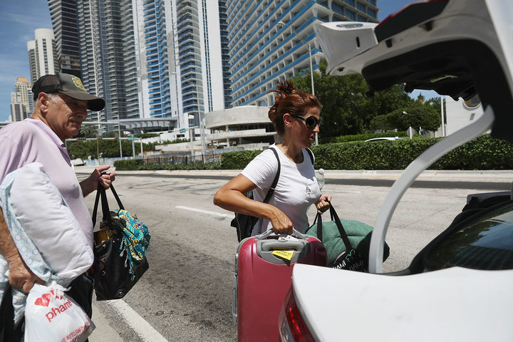Miama Beach, Florida residents evacuate ahead of the hurricane's arrival