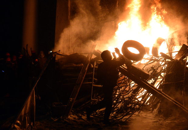 Barricades were set on fire in the latest clash in Kiev.