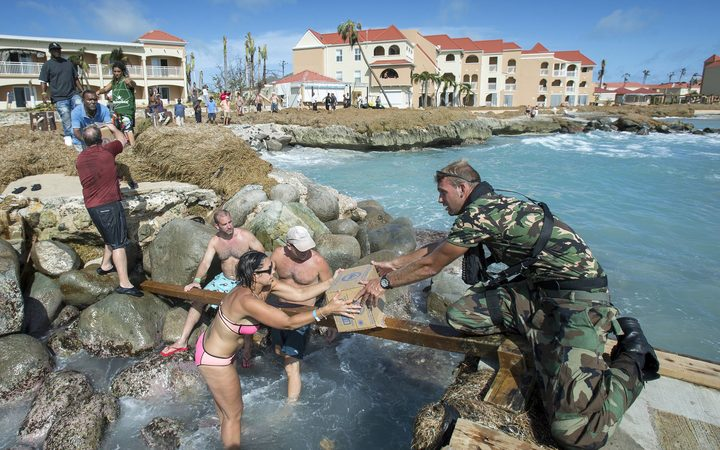 Navy personnel distributing supplies in Saint Martin.