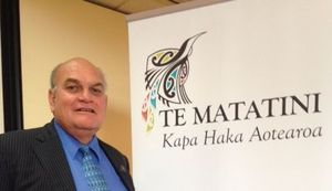 Te Matatini chairman, Selwyn Parata, next to the organisation's new brand.