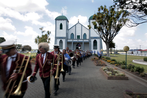 The Ratana Brass Band leaves the church.