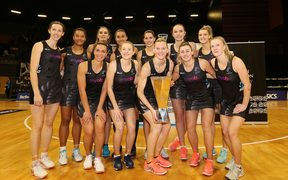 The Silver Ferns with the Taini Jamison Trophy after their series win over England