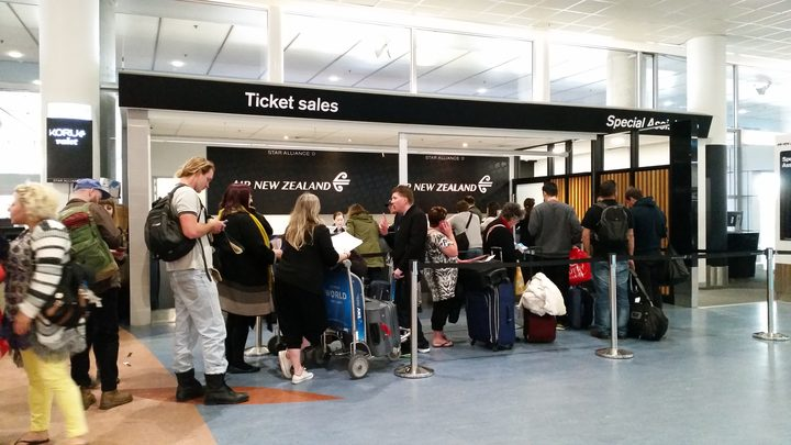 Air New Zealand passengers getting information after flights were cancelled.