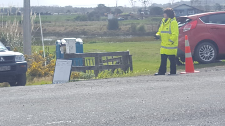 Security staff at the entrance to a property near the pipeline break on Ruakaka Road.
