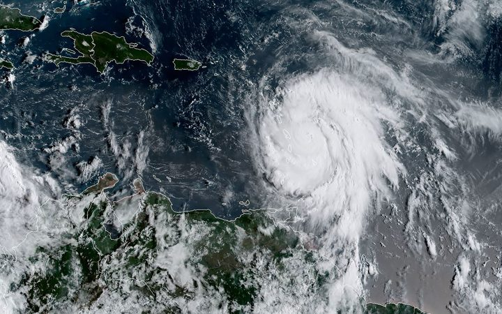 A satellite image from the US National Oceanic and Atmospheric Administration shows Hurricane Maria on 18 September.