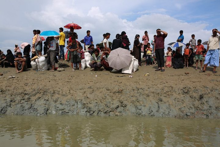 Rohingya Muslims who fled from ongoing military operations in Myanmar's Rakhine state wait for a boat to a makeshift camp on hills at Cox's Bazar, Bangladesh.