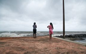 People look at the ocean in Basse-Terre, on the Fench Caribbean island of Guadeloupe, as Hurricane Maria approaches the Caribbean.
