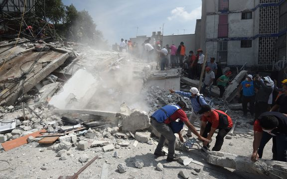 People search through debris for anyone  who may be trapped in falling buildings.
