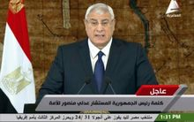 Interim President Adly Mansour giving a speech in Cairo.