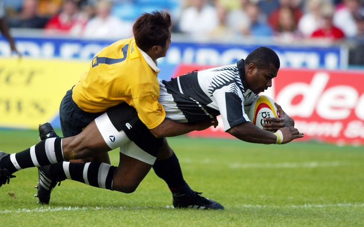 Fiji's Rupeni Caucaunibuca scores a try against Malaysia during the 2002 Commonwealth Games Sevens in Manchester.