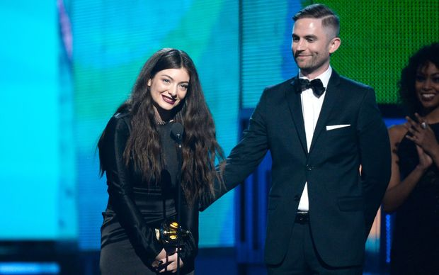 Lorde with producer Joel Little accepting the award for song of the year.