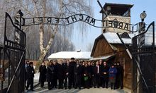 Members of the Knesset enter the main gate at the Auschwitz concententration camp in Poland on Holocaust Day.