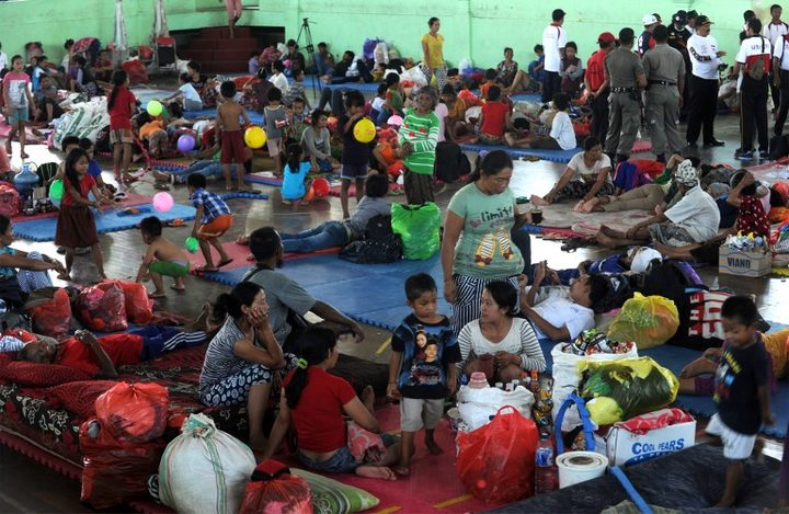 Villagers rest after being evacuated during the raised alert levels for the volcano on Mount Agung in Klungkung regency Bali