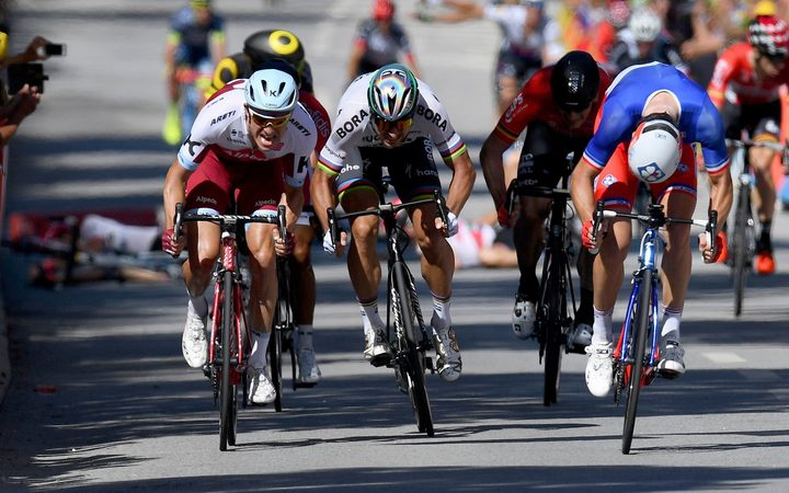 Peter Sagan (centre) leaves Mark Cavendish sprawling in the Tour de France