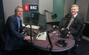 National Party leader Bill English (left) in the RNZ Auckland studio with Guyon Espiner.
