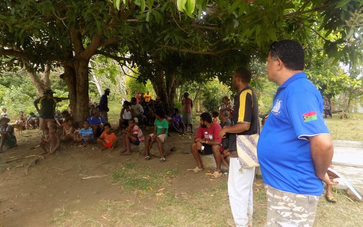 Villagers meet on the Vanuatu island of Ambae as officials tell them to prepare to evacuate.