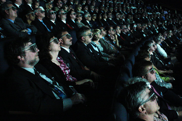 Movie goers watching a 3D film at an IMAX cinema