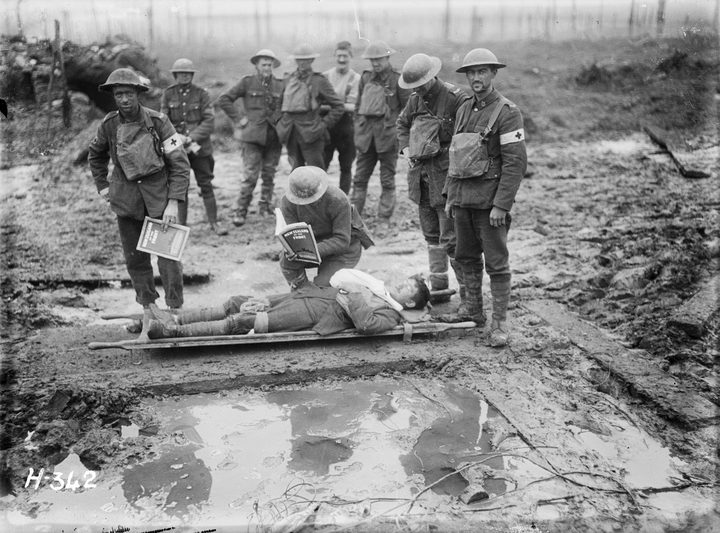 A wounded NZ soldier on a stretcher in Belgium, late 1917.