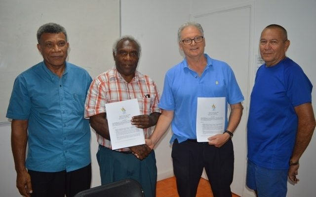 Van2017 CEO Clint Flood (2R) with representatives of Vanuatu's Seventh Day Adventist Mission.