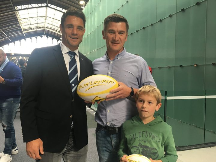 Dan Carter with Peyo's father Oliver, who is organising a memorial rugby match between Peyo's French and Kiwi friends.