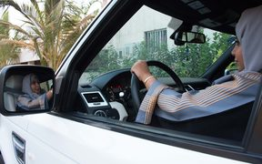 A Saudi woman drives her car in Jeddah, the day the ban was lifted