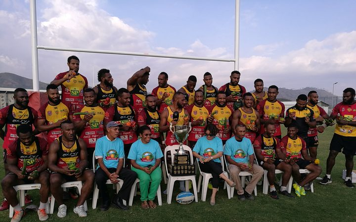 The PNG Hunters squad pose with the Intrust Super Cup trophy in Port Moresby.