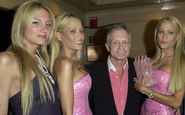 Playboy founder Hugh Hefner with three companions in 1999.
