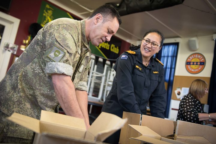About 40 schoolchildren, veterans, staff from Foodstuffs and Z Energy, and New Zealand Defence Force personnel packed hundreds of Christmas treats this morning for NZDF personnel serving overseas.