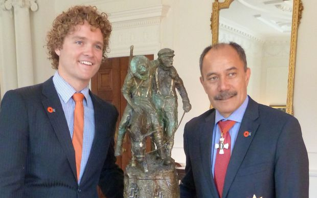 Sam Johnson, organiser of the Student Volunteer Army, left, and Governor General Sir Jerry Mateparae with 'The Governor General's ANZAC of the Year Trophy.