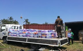 Supplies from New Zealand are unloaded in Vanuatu.