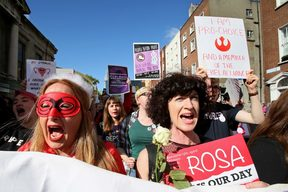 Protesters hold up placards as they take part in the March for Choice, calling for the legalising of abortion in Ireland after a referendum announcement.