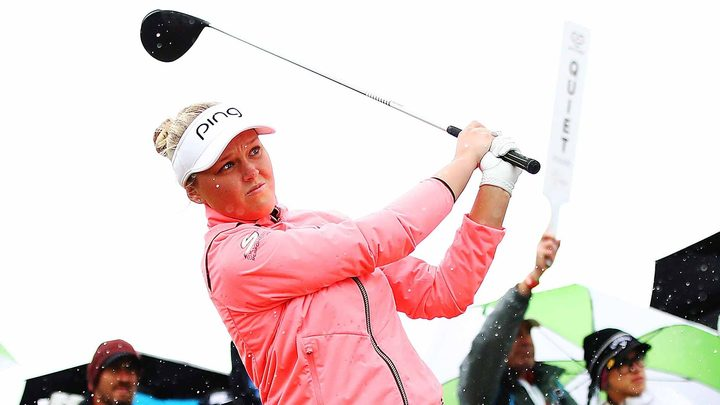 Canada's Brooke Henderson battles the wind and rain