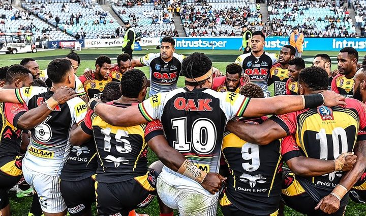 PNG Hunters and Penrith Panthers players huddle together following the NRL State Championship match.