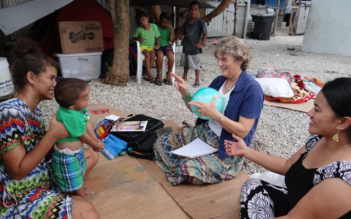 Early Hearing Detection and Intervention program staff Chinilla Peter (right) and Nancy Rushmer teach sign language to a mother and young child who is hearing impaired during a home visit in Majuro in this file photo from 2015.