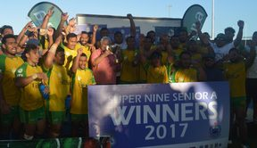 The Eels celebrate winning the inaugural Super 9 rugby title in Samoa, alongside Prime Minister Tuilaepa Sailele Malielegaoi.