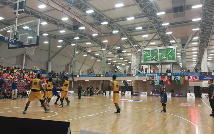 The PNG men, in yellow, taking on Solomon Islands during the Melanesian Basketball Cup in Port Moresby.