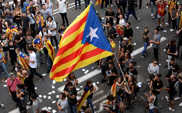 About 300,000 people took to the streets of Barcelona in protest at police actions during Sunday's referendum