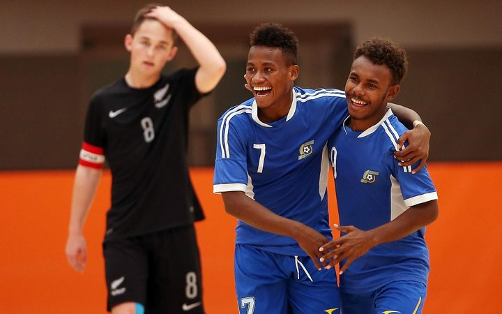 Raphael Le'ai (C) celebrates one of his 12 goals on day one of the OFC Youth Futsal Tournament in Auckland.