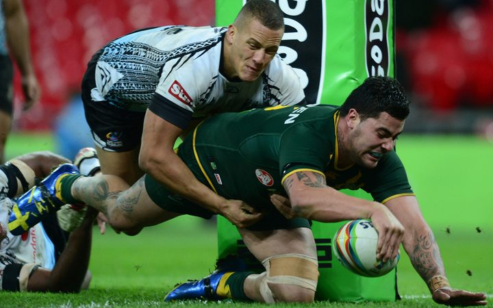 Andrew Fifita scores a try for Australia at the 2013 World Cup.