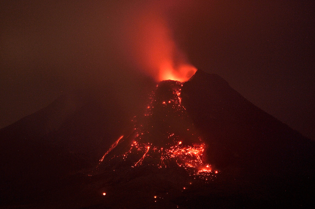 Molten lava flows from the crater of Mount Sinaberg on 27 January during a series of eruptions.