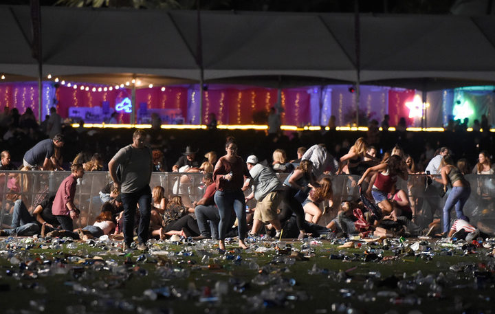 People run from the Route 91 Harvest country music festival.