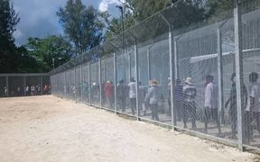 Detainees gather for the 64th day of protest on Manus Island.