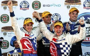Greg Murphy (R) and co driver Rick Kelly on the podium after winning Bathurst for the second year in a row.2004.