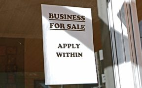 sign in window saying business for sale