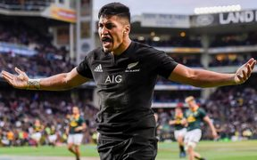 Rieko Ioane celebrates scoring a try against South Africa.