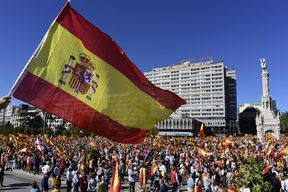Protesters gather holding Spanish flags during a demonstration against independence of Catalonia.