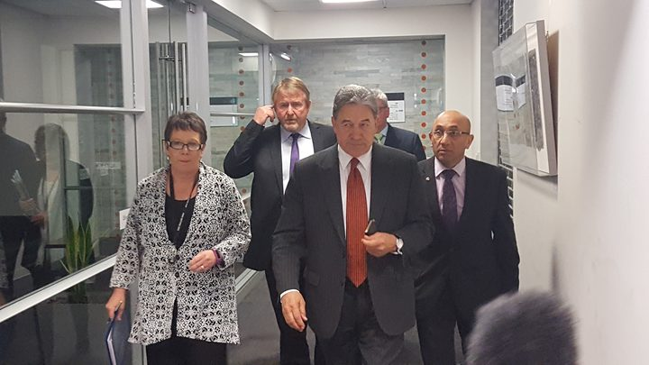Winston Peters (front) emerging from his meeting with National.