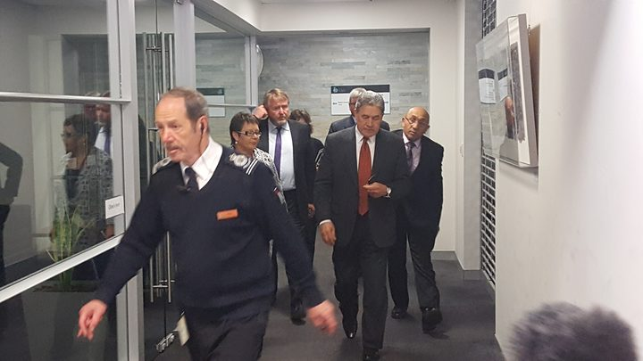 Winston Peters (second right) emerging from his meeting with National.
