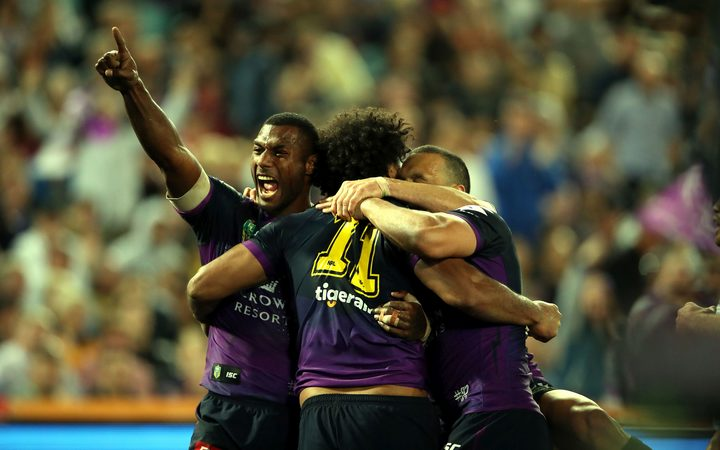 Suliasi Vunivalu (L) celebrates the try of Felise Kaufusi during the NRL Grand Final.
